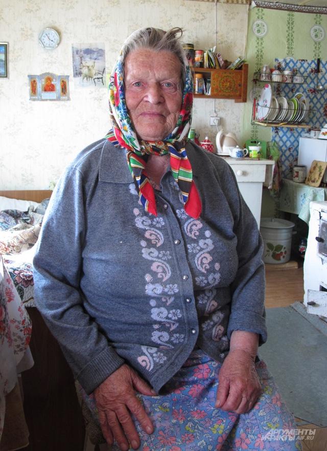 Галина Кузнецова, одна из старейших жительниц села Пурнема. Ей 83 года, но выглядит она, как и многие поморы, очень бодро