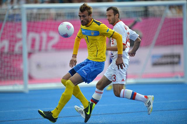Украинец Иван Доценко и россиянин Лаша Мурванадзе в финальном матче турнира по футболу 7 7 на ХIV летних Паралимпийских играх в Лондоне. 2012 год