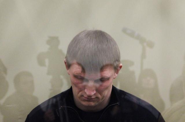 Один из бандитов банды Сергея Цапка Андрей Быков во время судебного заседания по делу об убийстве 12 человек в станице Кущевская, 2012 г.