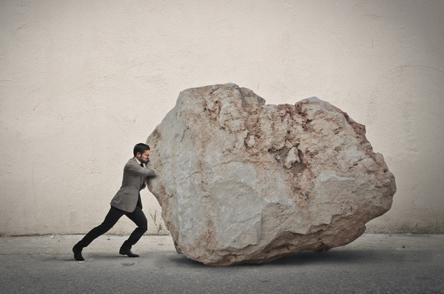 Трудоголик, бизнесмен, камень