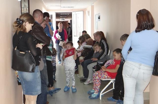 В детской поликлинике.