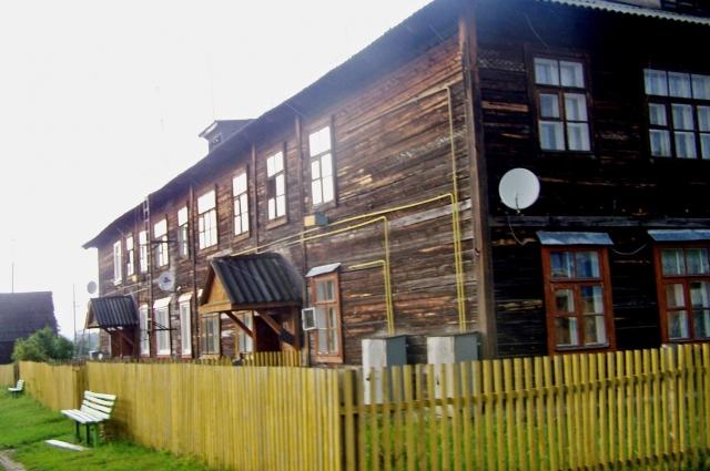 В таких домах эти 22 семьи жили ранее.