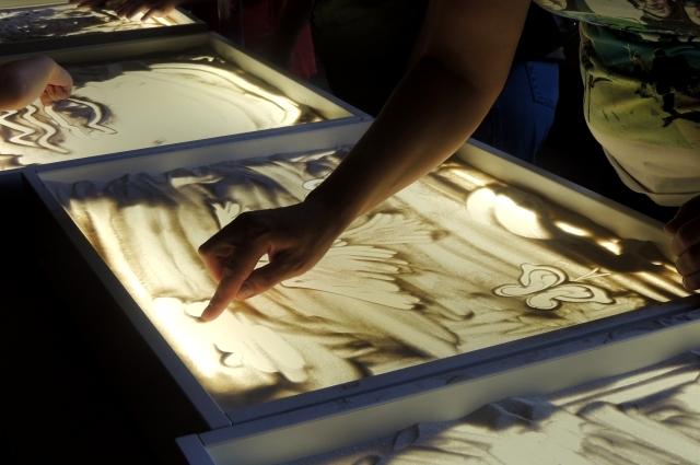 песочная анимация, рисование на песке