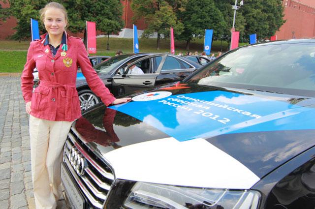 Олимпийская чемпионка в командных соревнованиях по синхронному плаванию Александра Пацкевич. 2012 год