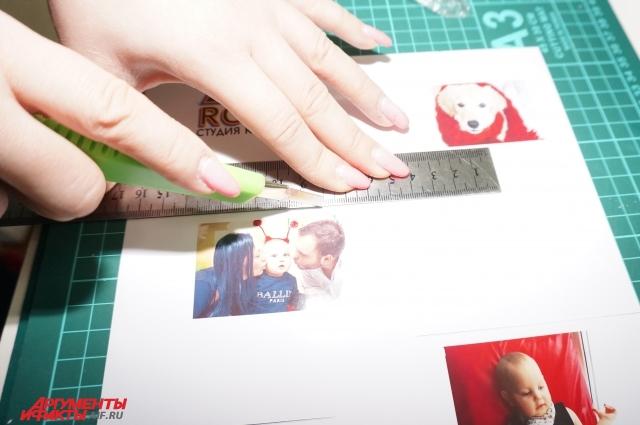 Распечатанные на фотобумаге кадры вырезаем на специальном коврике при помощи канцелярского ножа.