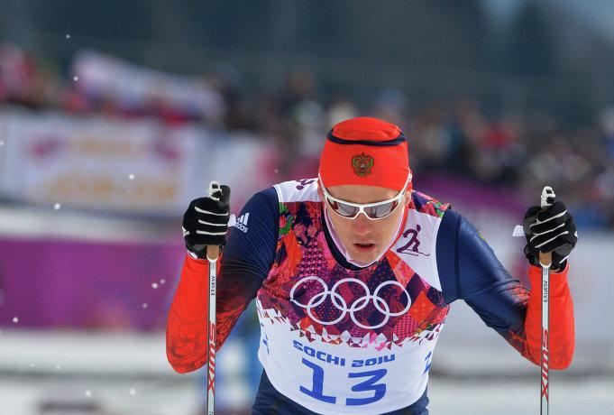 Олимпиада 2014. Никита Крюков на финише квалификационного забега индивидуального спринта в соревнованиях по лыжным гонкам среди мужчин