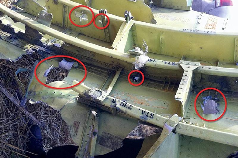 Обломки разбившегося на Донбассе Боинга 777