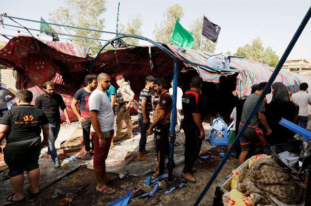 На месте теракта на рынке в районе Шааб в Багдаде.