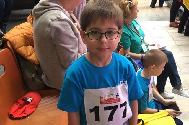 Андрей на Всемирных играх победителей, готовится к забегу на 60 метров.
