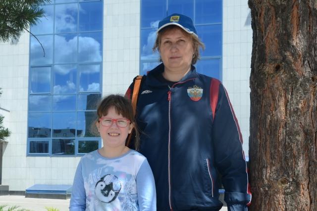 С тренером Ольгой Сухаревой.