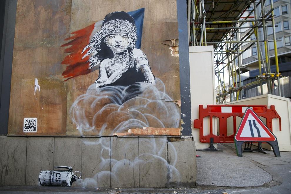 Граффити Бэнкси, посвященная беженцам в лагере Кале.