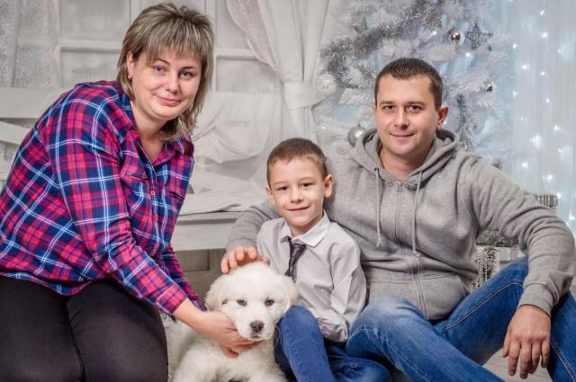 Евгения с мужем и сыном. После наводнения прошло восемь лет.