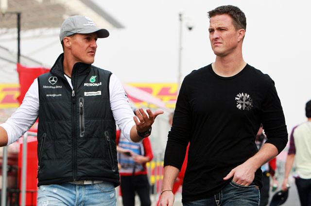 Михаэль Шумахер и Ральф Шумахер (справа).