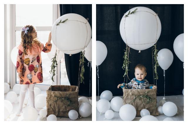 Варя и Тима пока не знают, кем станут, но охотно позируют на фоне шаров.