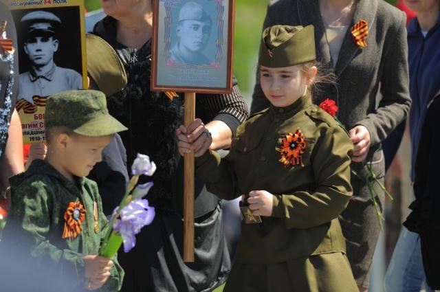 Пример снимка для конкурса. Героями фотографии могут быть ветераны, труженики тыла, дети, участвующие в патриотических акциях.