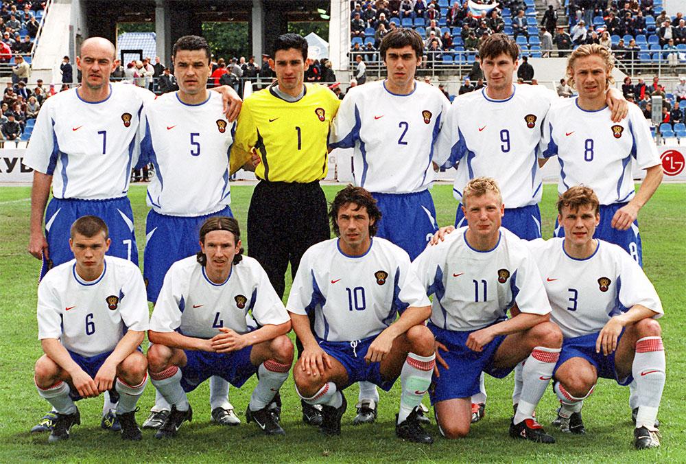 Russian national football team of 2002.  Top row (from left to right): Viktor Onopko (No. 7), Yuri Nikiforov (No. 5), Ruslan Nigmatullin (No. 1), Yuri Kovtun (No. 2 /, Egor Titov (No. 9), Valery Karpin (No. 8). row (from left to right): Marat Izmailov (No. 6), Alexey Smertin (No. 4), Alexander Mostovoy (No. 10), Vladimir Beschastnykh (No. 11), Andrey Solomatin (No. 3).