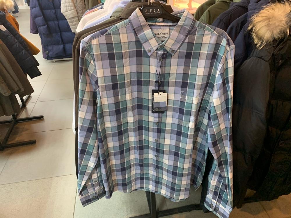 Клетчатая рубашка в магазине «Села» за 1199 рублей.
