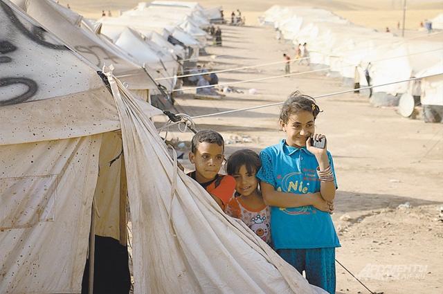Лагерь беженцев, христиан и шиитов, бежавших из Мосула